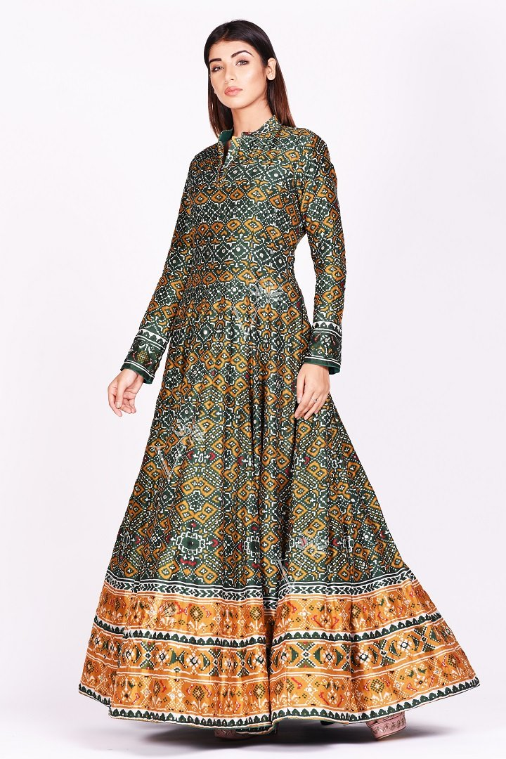 Buy green and mustard printed patola silk Anarkali suit online in USA. Make a stunning fashion statement at weddings and special occasions with an exquisite collection of designer Anarkali suits, traditional salwar suits, designer lehengas from Pure Elegance Indian fashion store in USA. -side1