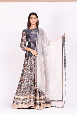 Buy dark grey embroidered and printed silk lehenga online in USA. Make a stunning fashion statement at weddings and special occasions with an exquisite collection of designer Anarkali suits, designer lehengas, Indian designer dresses from Pure Elegance Indian fashion store in USA. -front