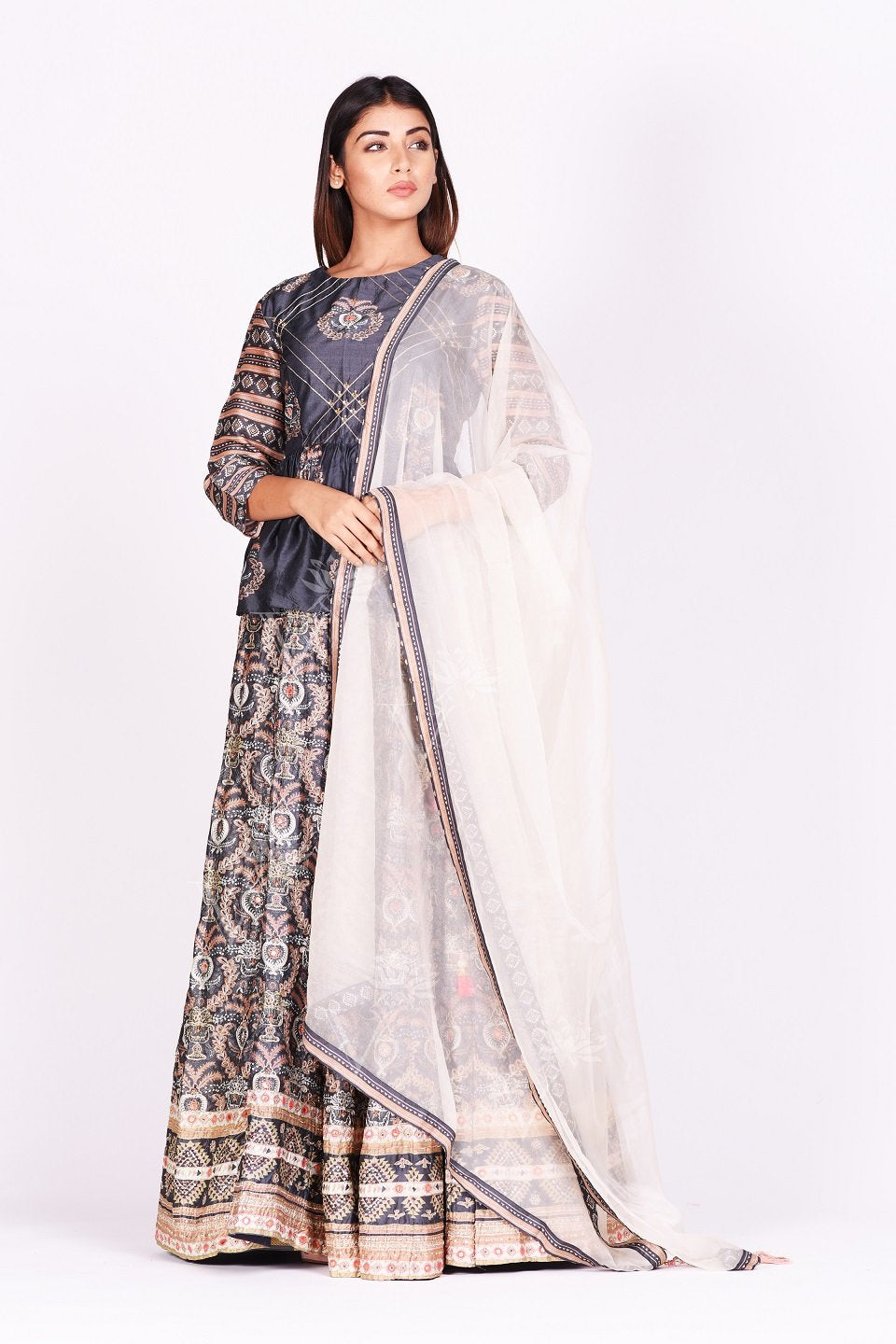 Buy dark grey embroidered and printed silk lehenga online in USA. Make a stunning fashion statement at weddings and special occasions with an exquisite collection of designer Anarkali suits, designer lehengas, Indian designer dresses from Pure Elegance Indian fashion store in USA. -full view