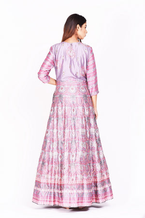 Shop lavender embroidered and printed silk Anarkali online in USA. Make a stunning fashion statement at weddings and special occasions with an exquisite collection of designer Anarkali suits, designer lehengas, Indian designer dresses from Pure Elegance Indian fashion store in USA. -back