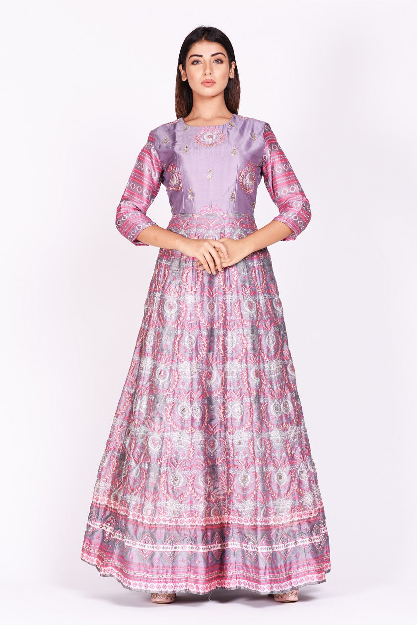 Shop lavender embroidered and printed silk Anarkali online in USA. Make a stunning fashion statement at weddings and special occasions with an exquisite collection of designer Anarkali suits, designer lehengas, Indian designer dresses from Pure Elegance Indian fashion store in USA. -full view