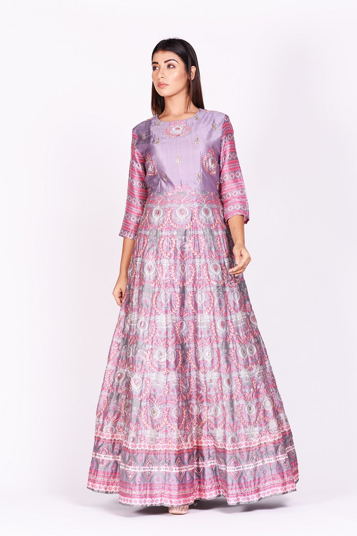 Shop lavender embroidered and printed silk Anarkali online in USA. Make a stunning fashion statement at weddings and special occasions with an exquisite collection of designer Anarkali suits, designer lehengas, Indian designer dresses from Pure Elegance Indian fashion store in USA. -front