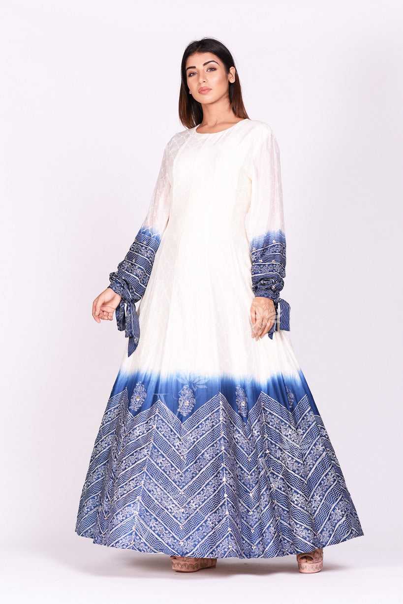 Shop ravishing white and blue printed chanderi silk Anarkali suit online in USA. Make a stunning fashion statement at weddings and special occasions with an exquisite collection of designer Anarkali suits, designer lehengas, Indian designer dresses from Pure Elegance Indian fashion store in USA. -frontpose