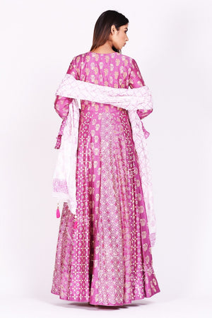 Shop lovely fuschia pink printed silk Anarkali suit online in USA with bell sleeves. Make a stunning fashion statement at weddings and special occasions with an exquisite collection of designer Anarkali suits, designer lehengas, Indian designer dresses from Pure Elegance Indian fashion store in USA. -back