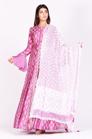 Shop lovely fuschia pink printed silk Anarkali suit online in USA with bell sleeves. Make a stunning fashion statement at weddings and special occasions with an exquisite collection of designer Anarkali suits, designer lehengas, Indian designer dresses from Pure Elegance Indian fashion store in USA. -front