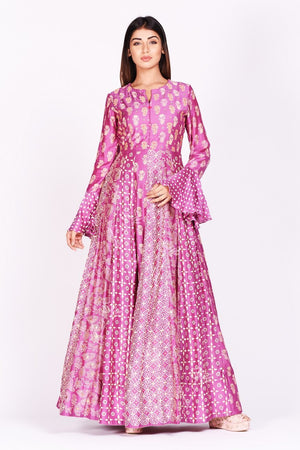 Shop lovely fuschia pink printed silk Anarkali suit online in USA with bell sleeves. Make a stunning fashion statement at weddings and special occasions with an exquisite collection of designer Anarkali suits, designer lehengas, Indian designer dresses from Pure Elegance Indian fashion store in USA. -frontpose
