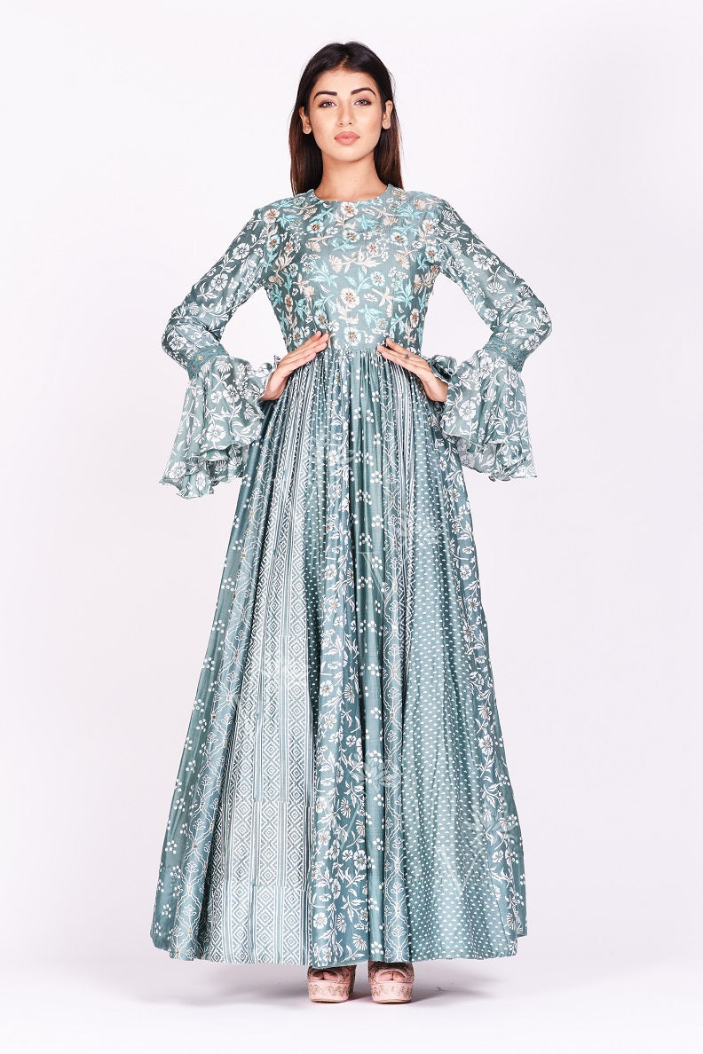 Shop gorgeous sage green printed silk Anarkali dress online in USA with bell sleeves. Make a stunning fashion statement at weddings and special occasions with an exquisite collection of designer Anarkali suits, designer lehengas, Indian designer dresses from Pure Elegance Indian fashion store in USA. -frontpose