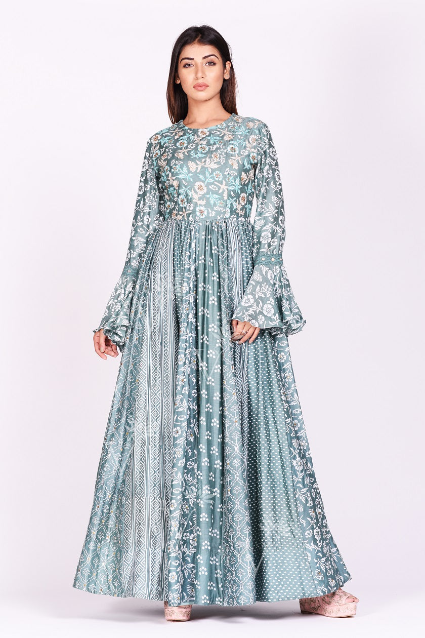 Shop gorgeous sage green printed silk Anarkali dress online in USA with bell sleeves. Make a stunning fashion statement at weddings and special occasions with an exquisite collection of designer Anarkali suits, designer lehengas, Indian designer dresses from Pure Elegance Indian fashion store in USA. -full view