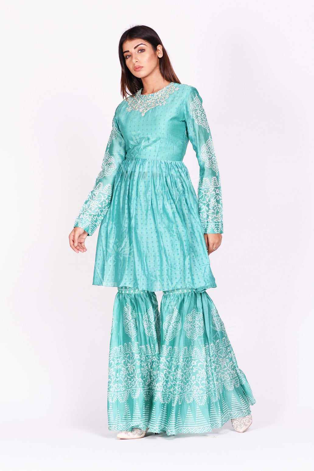 Buy stunning mint green printed silk sharara set online in USA. Make a stunning fashion statement at weddings and special occasions with an exquisite collection of designer Anarkali suits, designer lehengas, Indian designer dresses from Pure Elegance Indian fashion store in USA. -sidepose