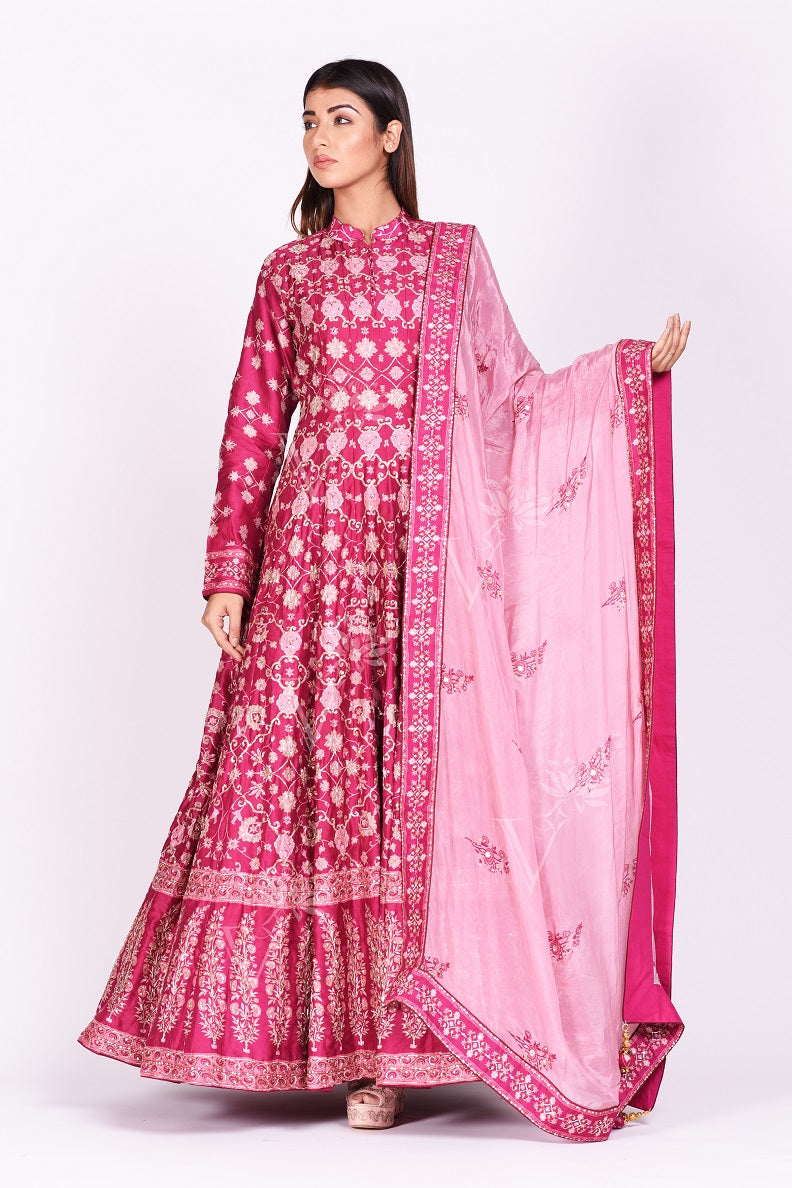 Shop striking pink printed embroidered silk floorlength Anarkali suit online in USA with dupatta. Make a stunning fashion statement at weddings and special occasions with an exquisite collection of designer Anarkali suits, designer lehengas, Indian designer dresses from Pure Elegance Indian fashion store in USA. -full view