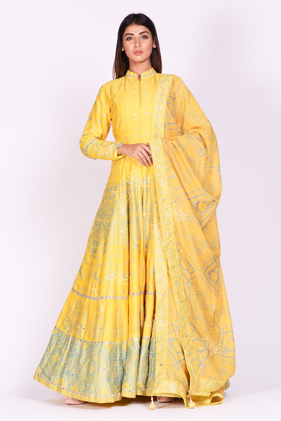 Shop yellow printed and mirror embroidery silk Anarkali online in USA with dupatta. Make a stunning fashion statement at weddings and special occasions with an exquisite collection of designer Anarkali suits, designer lehengas, Indian designer dresses from Pure Elegance Indian fashion store in USA. -frontpose