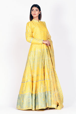 Shop yellow printed and mirror embroidery silk Anarkali online in USA with dupatta. Make a stunning fashion statement at weddings and special occasions with an exquisite collection of designer Anarkali suits, designer lehengas, Indian designer dresses from Pure Elegance Indian fashion store in USA. -side