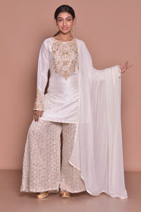 Buy beautiful white embroidered sharara suit online in USA with white dupatta. Be occasion ready with exquisite range of designer salwar suits, Anarkali suits from Pure Elegance Indian boutique in USA.-full view