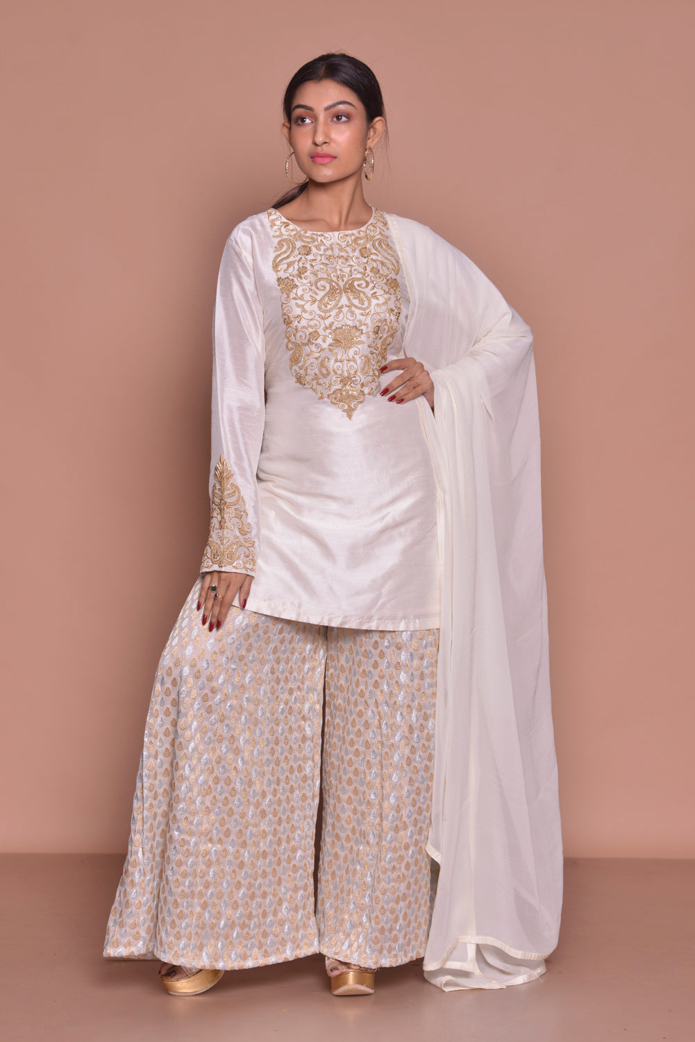 Buy beautiful white embroidered sharara suit online in USA with white dupatta. Be occasion ready with exquisite range of designer salwar suits, Anarkali suits from Pure Elegance Indian boutique in USA.-front