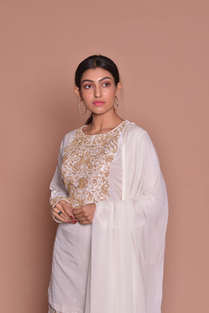 Buy beautiful white embroidered sharara suit online in USA with white dupatta. Be occasion ready with exquisite range of designer salwar suits, Anarkali suits from Pure Elegance Indian boutique in USA.-closeup