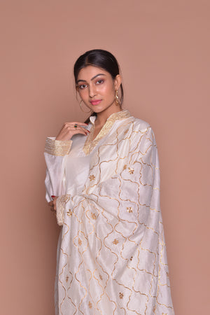 Buy beautiful white Indian suit online in USA with golden embroidery and pants. Be occasion ready with exquisite range of designer salwar suits, Anarkali suits from Pure Elegance Indian boutique in USA.-closeup