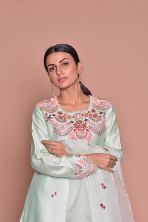 Shop elegant mint green embroidered suit online in USA with palazzo and dupatta. Flaunt Indian fashion with exquisite designer suits, Anarkali suits, sharara suits from Pure Elegance Indian cloth store in USA. -closeup
