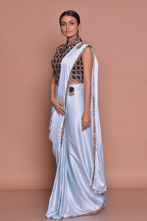 Buy light blue designer draped saree  online in USA with embroidered saree blouse. Flaunt Indian fashion with exquisite designer sarees, partywear sarees, bridal sarees from Pure Elegance Indian cloth store in USA. -side