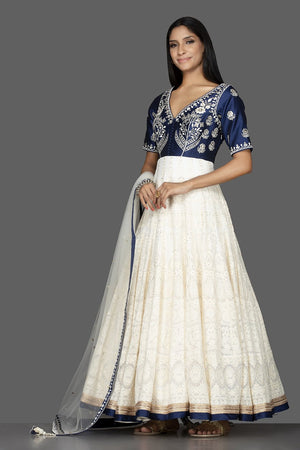 Buy beautiful off-white and blue Lucknowi work georgette Anarkali suit online in USA with dupatta. Spread ethnic elegance on weddings and special occasions in splendid designer lehengas, Anarkali suits crafted with exquisite Indian craftsmanship from Pure Elegance Indian fashion store in USA.-side