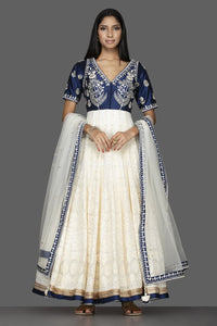 Buy beautiful off-white and blue Lucknowi work georgette Anarkali suit online in USA with dupatta. Spread ethnic elegance on weddings and special occasions in splendid designer lehengas, Anarkali suits crafted with exquisite Indian craftsmanship from Pure Elegance Indian fashion store in USA.-full view