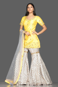 Shop beautiful yellow and grey embroidered cotton silk garara suit online in USA with dupatta. Spread ethnic elegance on weddings and special occasions in splendid designer lehengas, Anarkali suits crafted with exquisite Indian craftsmanship from Pure Elegance Indian fashion store in USA.-full view