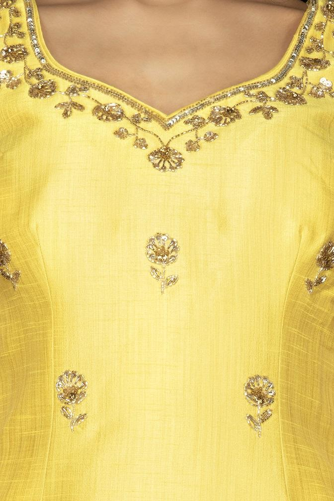 Shop beautiful yellow and grey embroidered cotton silk garara suit online in USA with dupatta. Spread ethnic elegance on weddings and special occasions in splendid designer lehengas, Anarkali suits crafted with exquisite Indian craftsmanship from Pure Elegance Indian fashion store in USA.-top