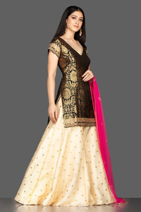 Buy gorgeous black and cream embroidered net and Banarasi sharara suit online in USA with pink dupatta. Spread ethnic elegance on weddings and special occasions in splendid designer lehengas, Anarkali suits crafted with exquisite Indian craftsmanship from Pure Elegance Indian fashion store in USA.-full view