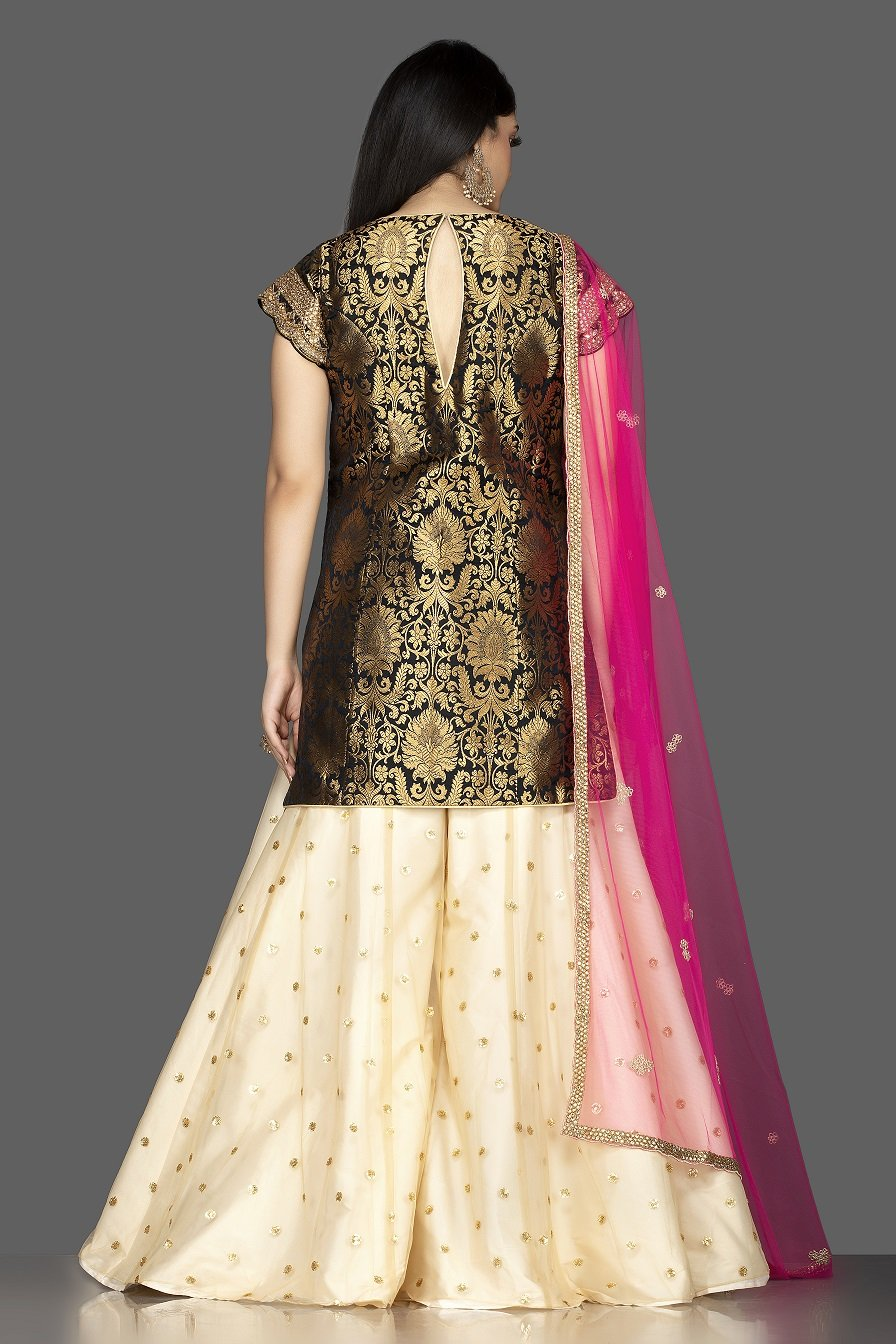 Buy gorgeous black and cream embroidered net and Banarasi sharara suit online in USA with pink dupatta. Spread ethnic elegance on weddings and special occasions in splendid designer lehengas, Anarkali suits crafted with exquisite Indian craftsmanship from Pure Elegance Indian fashion store in USA.-back