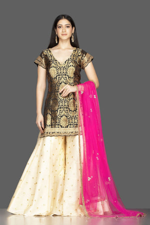 Buy gorgeous black and cream embroidered net and Banarasi sharara suit online in USA with pink dupatta. Spread ethnic elegance on weddings and special occasions in splendid designer lehengas, Anarkali suits crafted with exquisite Indian craftsmanship from Pure Elegance Indian fashion store in USA.-front