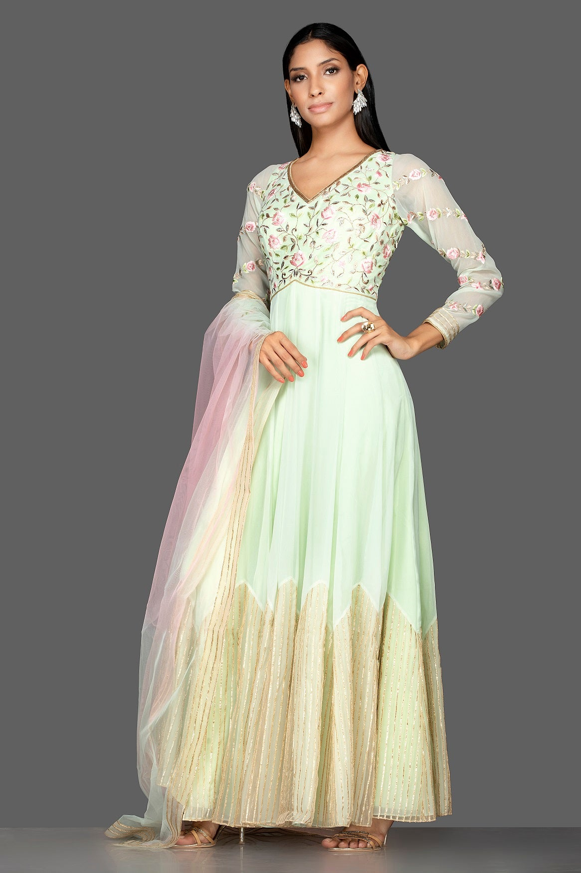 Buy mint green embroidered net floorlength Anarkali online in USA with dupatta. Spread ethnic elegance on weddings and special occasions in splendid designer lehengas, Anarkali suits crafted with exquisite Indian craftsmanship from Pure Elegance Indian fashion store in USA.-side