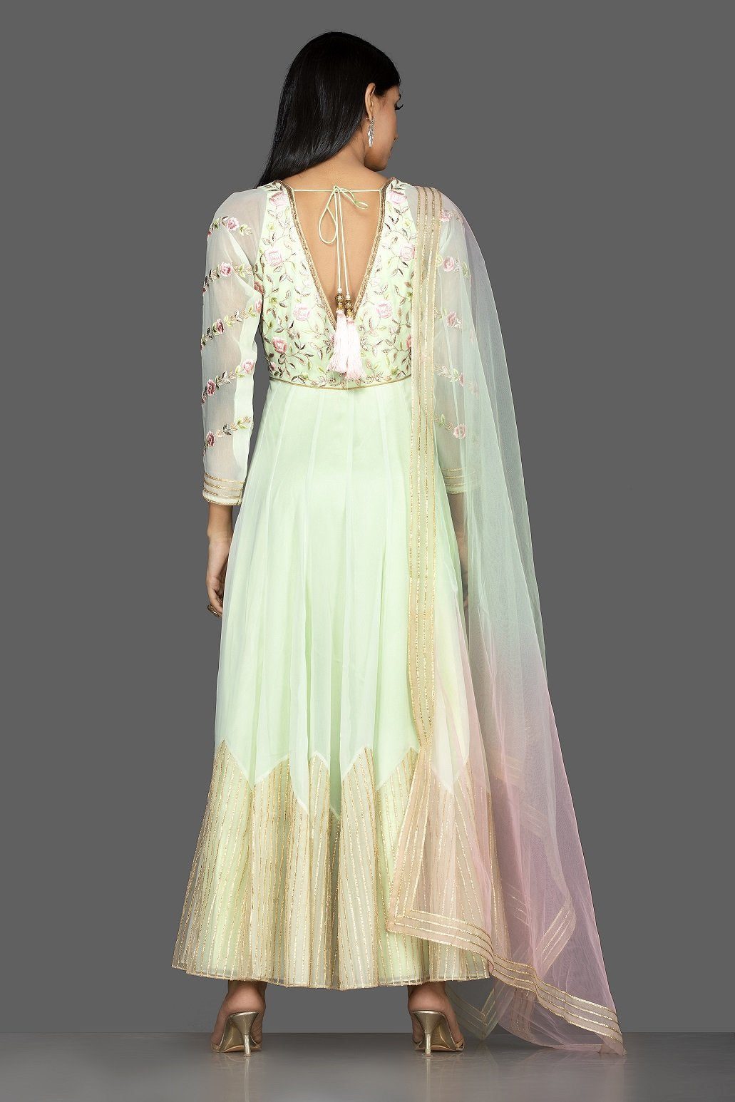 Buy mint green embroidered net floorlength Anarkali online in USA with dupatta. Spread ethnic elegance on weddings and special occasions in splendid designer lehengas, Anarkali suits crafted with exquisite Indian craftsmanship from Pure Elegance Indian fashion store in USA.-back