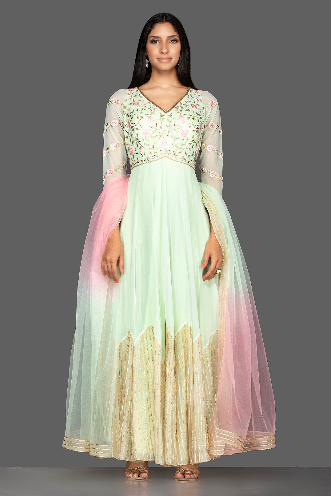 Buy mint green embroidered net floorlength Anarkali online in USA with dupatta. Spread ethnic elegance on weddings and special occasions in splendid designer lehengas, Anarkali suits crafted with exquisite Indian craftsmanship from Pure Elegance Indian fashion store in USA.-full view
