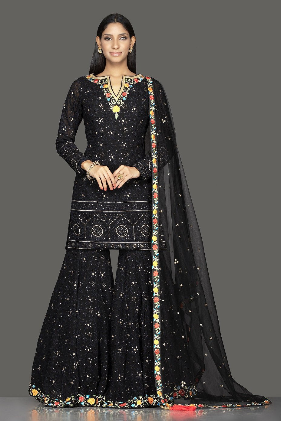 Buy stunning black georgette Lucknowi work garara suit online in USA with dupatta. Spread ethnic elegance on weddings and special occasions in splendid designer lehengas, Anarkali suits crafted with exquisite Indian craftsmanship from Pure Elegance Indian fashion store in USA.-full view