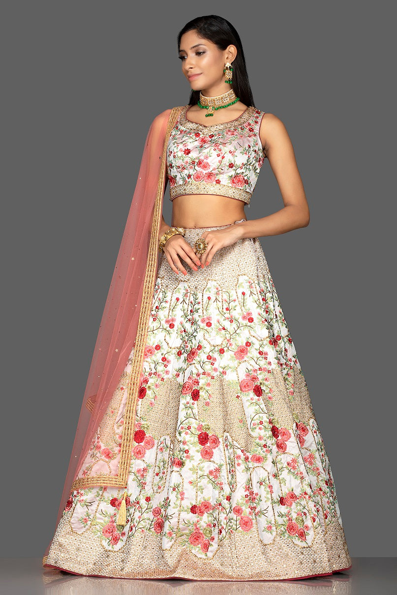 Shop powder pink stone and resham embroidery silk lehenga online in USA with pink net dupatta. Look radiant on weddings and special occasions in splendid designer Indian dresses, wedding lehengas crafted with finest embroideries and stunning silhouettes from Pure Elegance Indian fashion boutique in USA.-full view