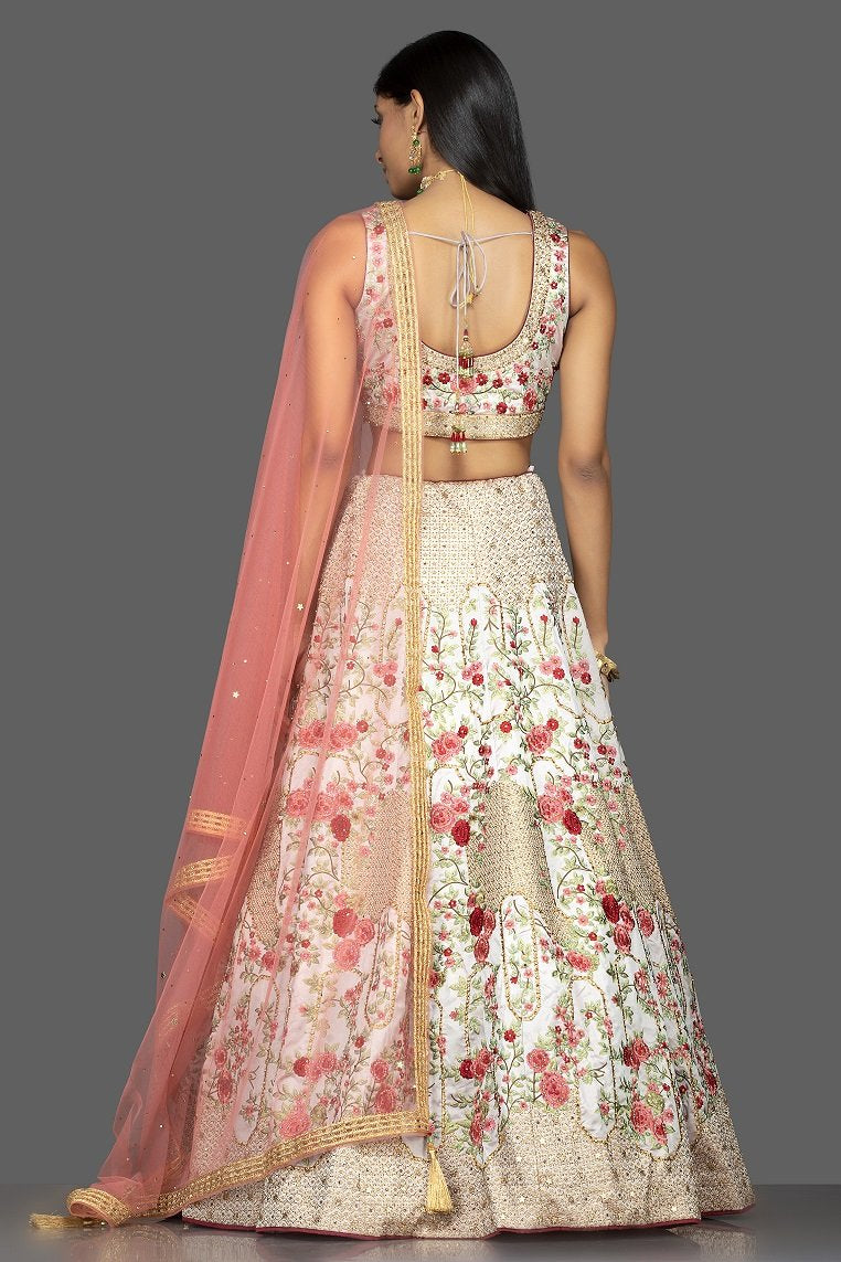 Shop powder pink stone and resham embroidery silk lehenga online in USA with pink net dupatta. Look radiant on weddings and special occasions in splendid designer Indian dresses, wedding lehengas crafted with finest embroideries and stunning silhouettes from Pure Elegance Indian fashion boutique in USA.-back