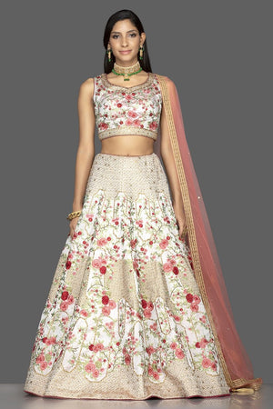 Shop powder pink stone and resham embroidery silk lehenga online in USA with pink net dupatta. Look radiant on weddings and special occasions in splendid designer Indian dresses, wedding lehengas crafted with finest embroideries and stunning silhouettes from Pure Elegance Indian fashion boutique in USA.-front