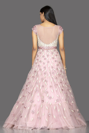 Shop baby pink pearl embroidery designer net gown online in USA. Look radiant on weddings and special occasions in splendid designer Indian dresses, wedding lehengas crafted with finest embroideries and stunning silhouettes from Pure Elegance Indian fashion boutique in USA.-back