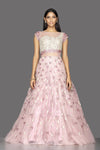 Shop baby pink pearl embroidery designer net gown online in USA. Look radiant on weddings and special occasions in splendid designer Indian dresses, wedding lehengas crafted with finest embroideries and stunning silhouettes from Pure Elegance Indian fashion boutique in USA.-front