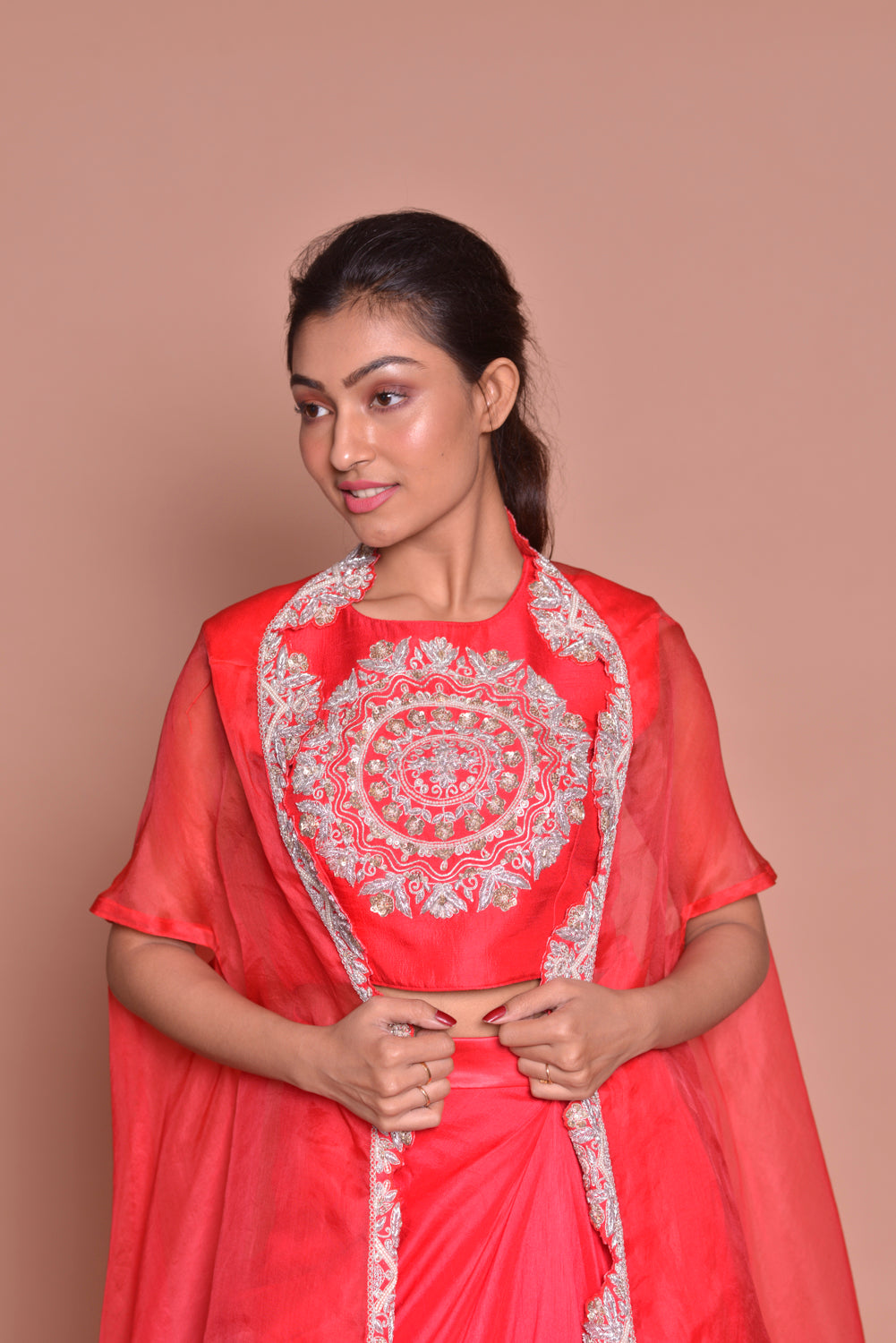Buy red embroidered crop top online in USA with draped skirt and cape. Get ready for festive occasions with exquisite designer dresses, salwar suits, sharara suits  from Pure Elegance Indian clothing store in USA.-closeup