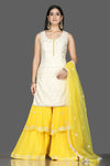 Shop white Lucknowi kurta online in USA with yellow georgette sharara. Flaunt ethnic fashion with exquisite designer lehenga, Indian wedding dresses, Anarkali suits from Pure Elegance Indian fashion boutique in USA.-full view