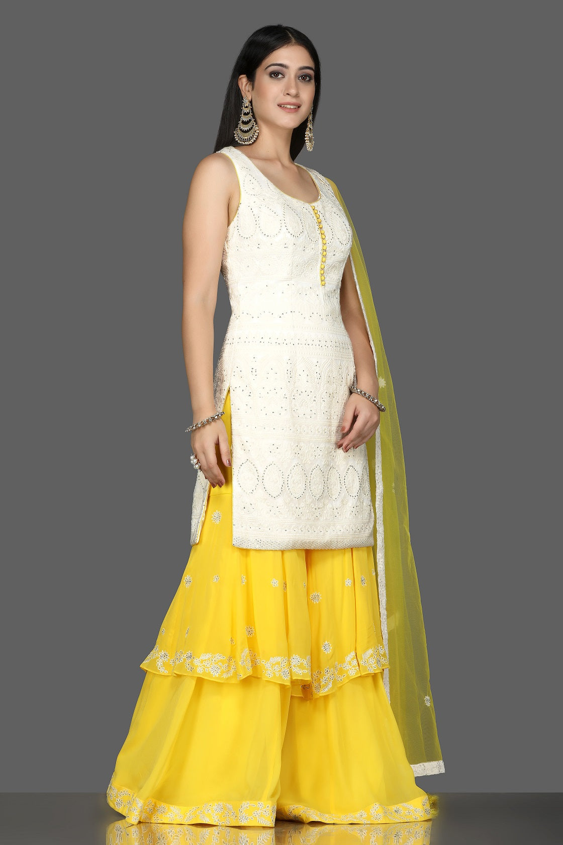 Shop white Lucknowi kurta online in USA with yellow georgette sharara. Flaunt ethnic fashion with exquisite designer lehenga, Indian wedding dresses, Anarkali suits from Pure Elegance Indian fashion boutique in USA.-side