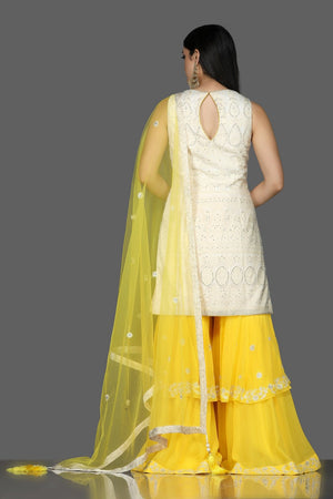 Shop white Lucknowi kurta online in USA with yellow georgette sharara. Flaunt ethnic fashion with exquisite designer lehenga, Indian wedding dresses, Anarkali suits from Pure Elegance Indian fashion boutique in USA.-back