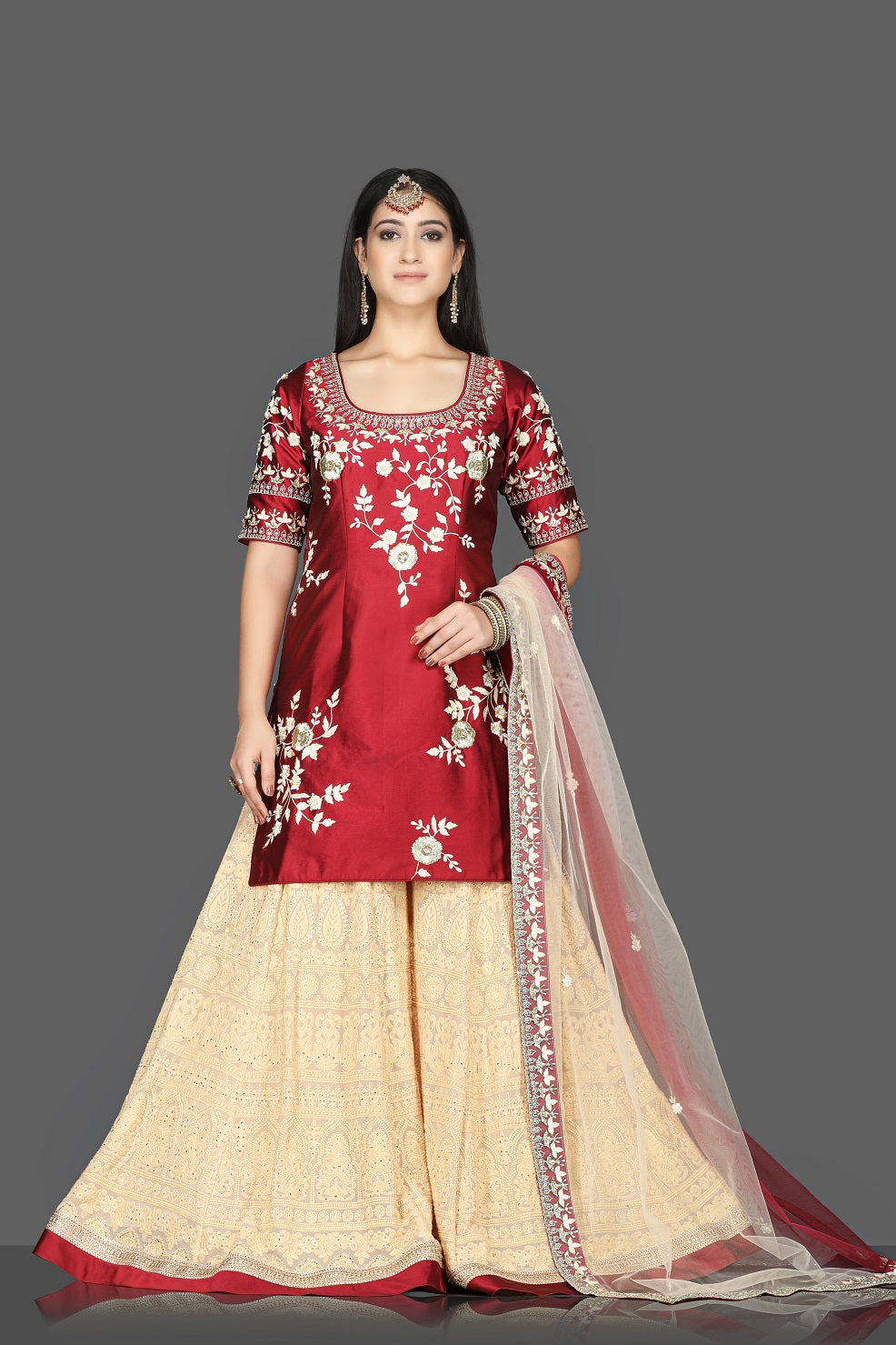 Buy red and cream embroidered raw silk net sharara suit online in USA with dupatta. Flaunt ethnic fashion with exquisite designer lehenga, Indian wedding dresses, Anarkali suits from Pure Elegance Indian fashion boutique in USA.-full view