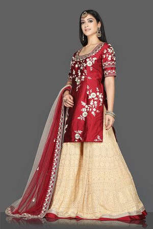 Buy red and cream embroidered raw silk net sharara suit online in USA with dupatta. Flaunt ethnic fashion with exquisite designer lehenga, Indian wedding dresses, Anarkali suits from Pure Elegance Indian fashion boutique in USA.-side