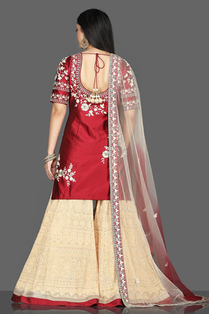 Buy red and cream embroidered raw silk net sharara suit online in USA with dupatta. Flaunt ethnic fashion with exquisite designer lehenga, Indian wedding dresses, Anarkali suits from Pure Elegance Indian fashion boutique in USA.-back