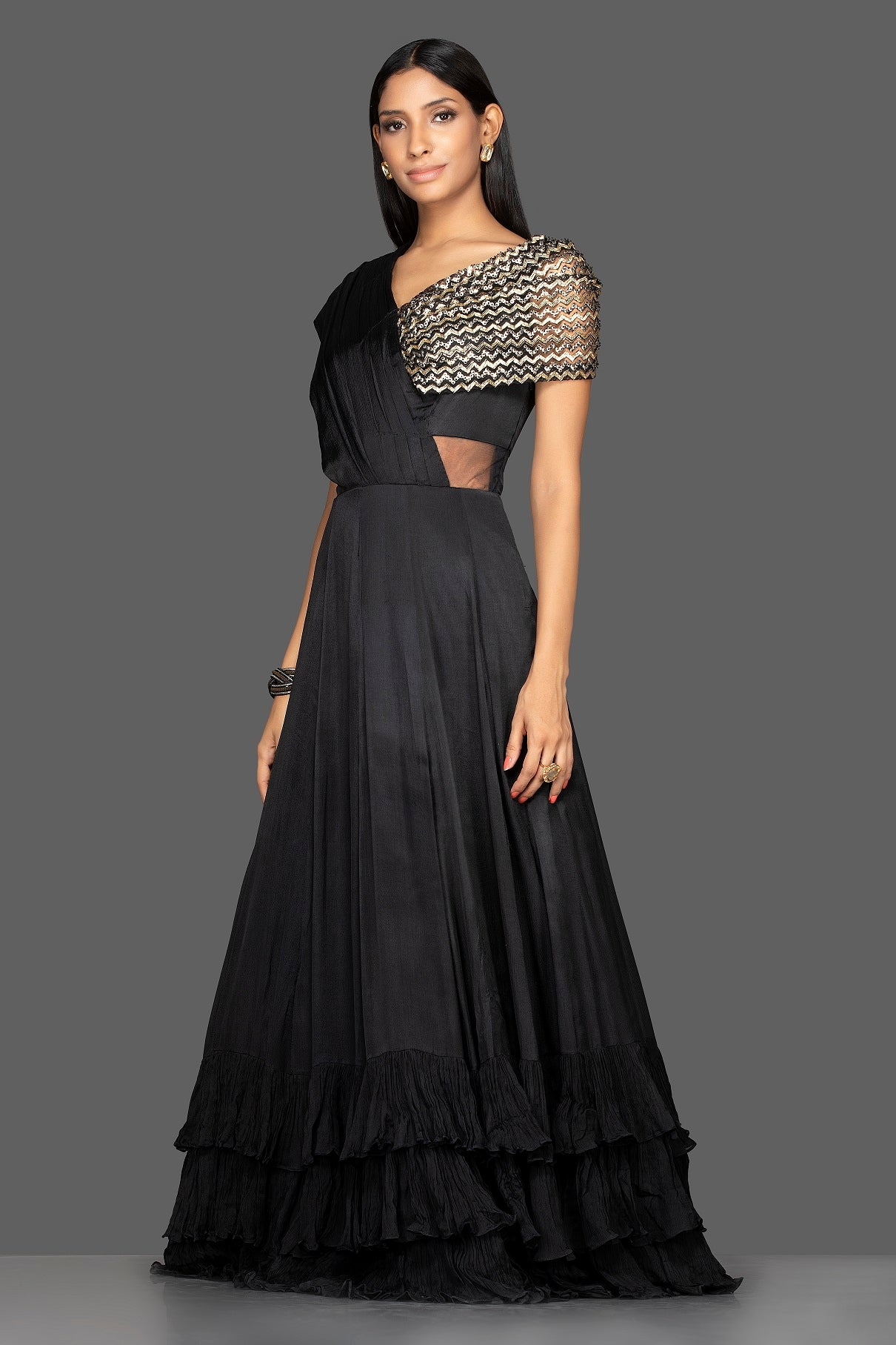Shop stylish black embroidered georgette layered ruffle gown online in USA. Flaunt your extraordinary fashion sense with stunning Indian dresses, designer gowns from Pure Elegance Indian fashion store in USA.-side