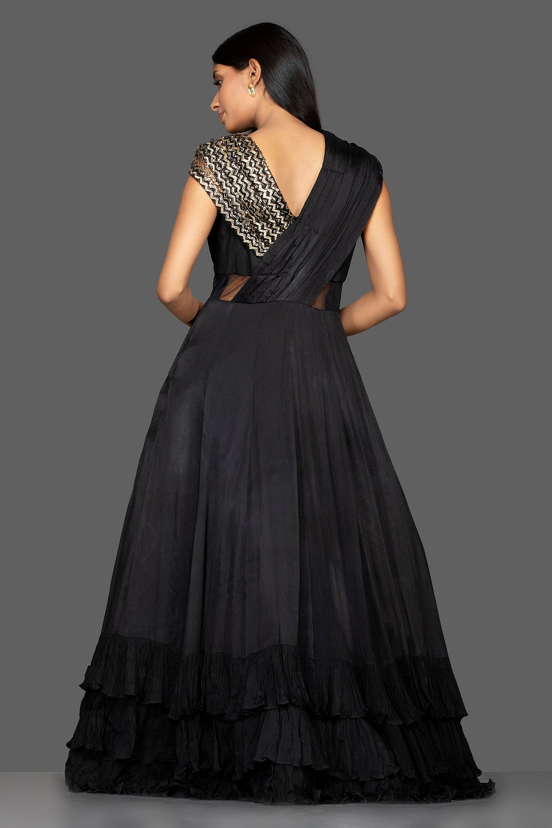 Shop stylish black embroidered georgette layered ruffle gown online in USA. Flaunt your extraordinary fashion sense with stunning Indian dresses, designer gowns from Pure Elegance Indian fashion store in USA.-back