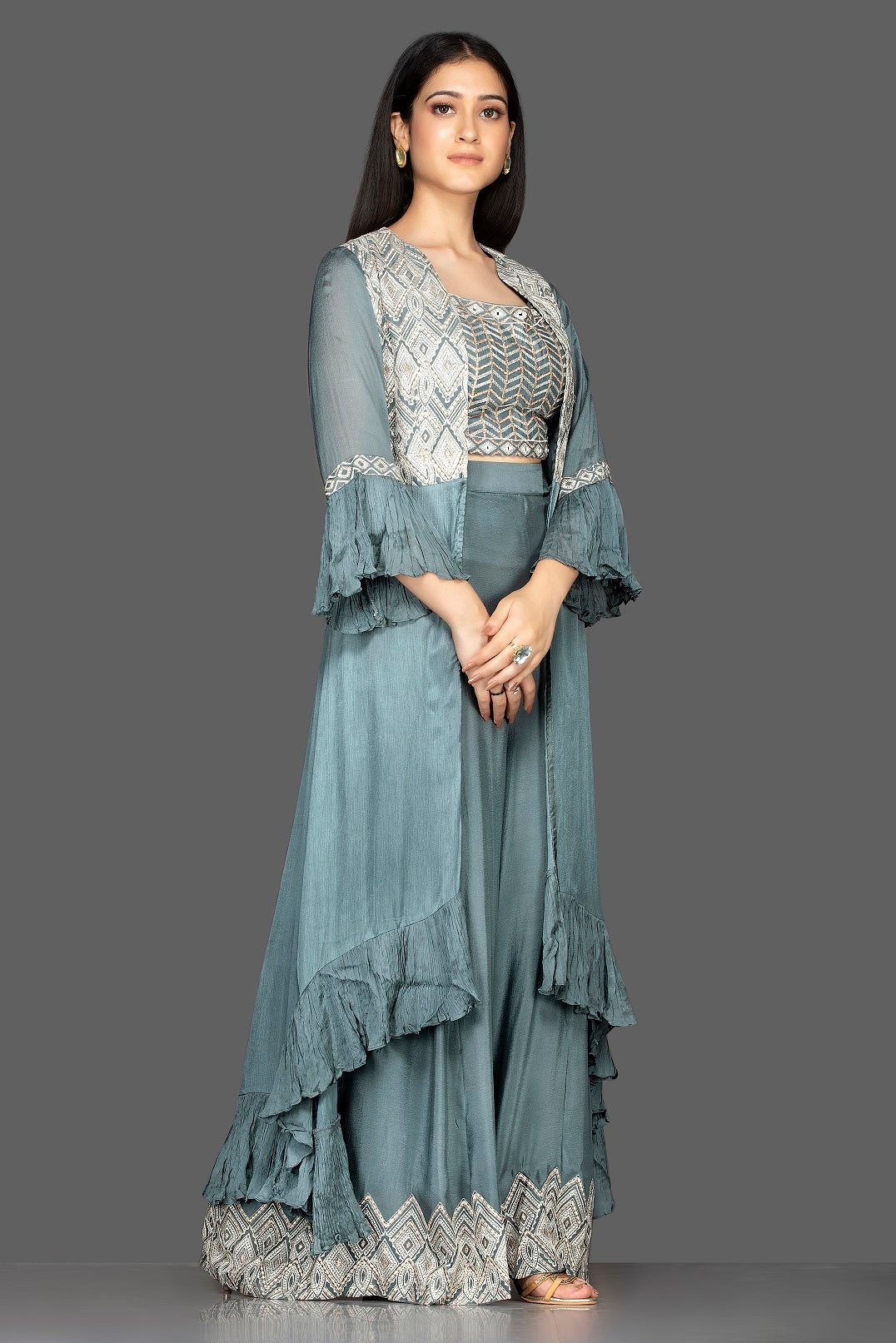Shop sea green embroidered crop top and palazzo online in USA with long shrug. Flaunt your extraordinary fashion sense with stunning Indowestern dresses, designer Anarkali suits from Pure Elegance Indian fashion store in USA.-side
