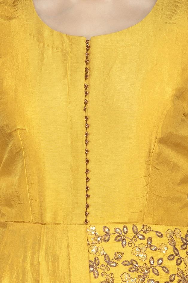 Shop attractive yellow embroidered chanderi silk Anarkali with dupatta online in USA. Flaunt your extraordinary fashion sense with stunning Indowestern dresses, designer Anarkali suits from Pure Elegance Indian fashion store in USA.-closeup