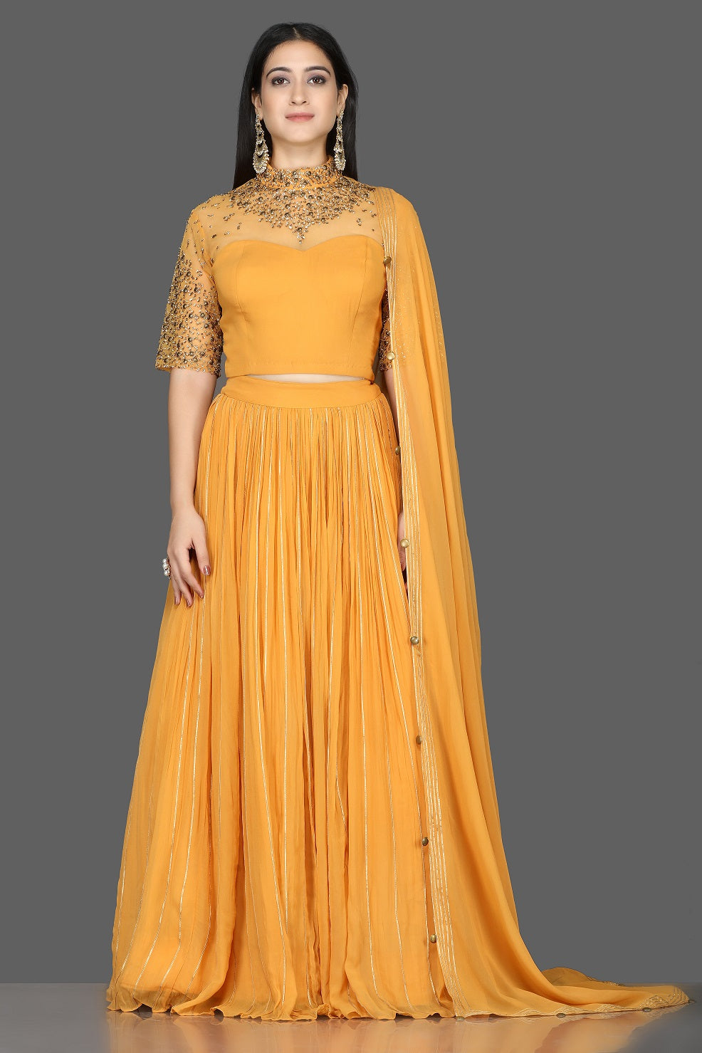 Shop beautiful mustard embroidered georgette lehenga online in USA with dupatta. Flaunt your extraordinary fashion sense with stunning Indian dresses, designer lehenga from Pure Elegance Indian fashion store in USA.-full view
